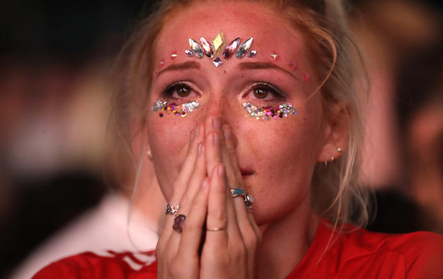 An England soccer fan reacts after England lost the semifinal match between Croatia and England at the 2018 soccer World Cup, in Hyde Park, London, Wednesday, July 11, 2018. (AP Photo/Matt Dunham)