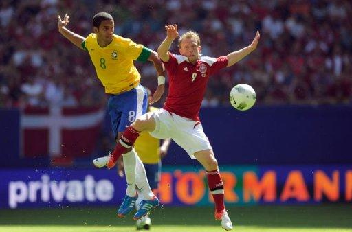 Brazil's midfielder Anderson Hernanes (L) and Denmark's striker Michael Krohn-Dehli jump for the ball