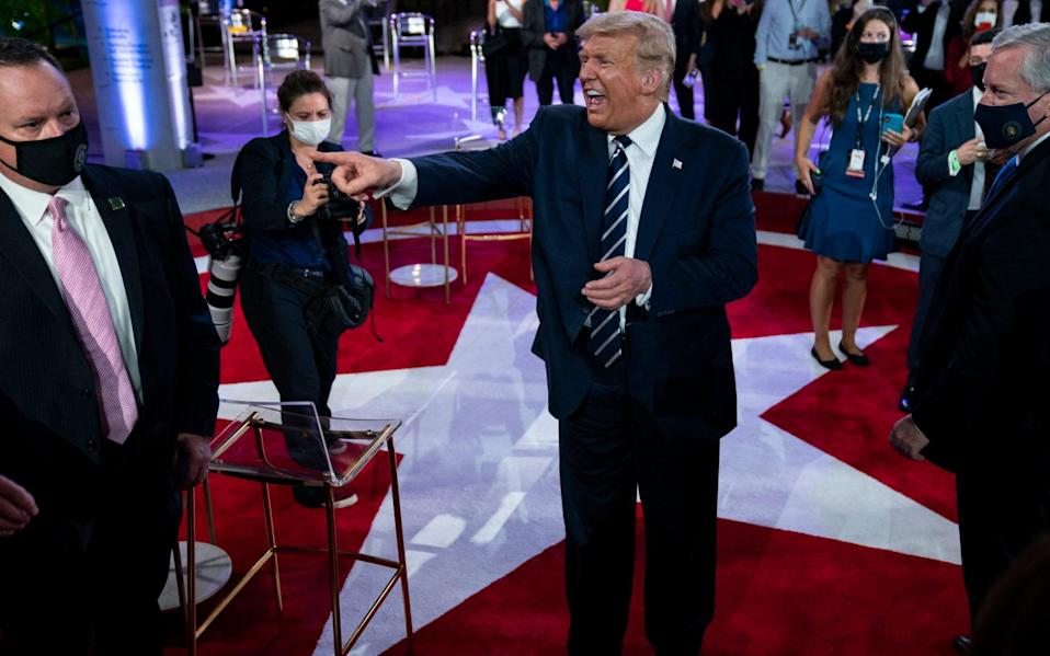 Donald Trump talks with voters after an NBC News Town Hall - AP