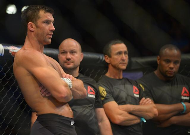 Luke Rockhold (L) stands in the cage after he was defeated by Michael Bisping at UFC 199. (Getty)