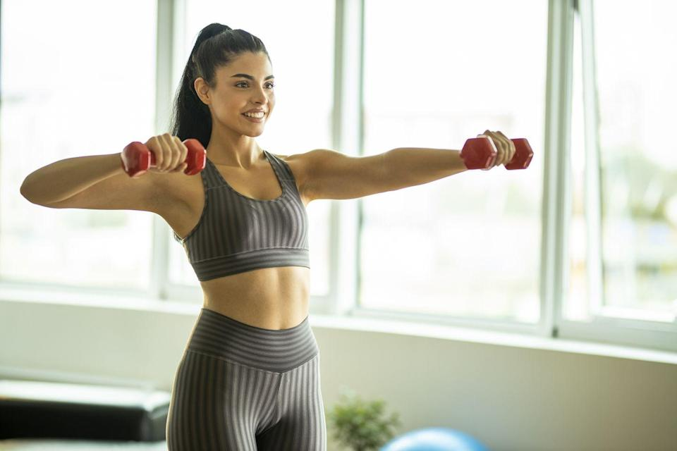 <p>Build sculpted and strong shoulders with this simple but effective lateral raise variation.</p><p><strong>How to: </strong>Standing tall with your feet shoulder width apart and holding a dumbbell in each hand. Bend your elbows to create a 90 degree angle and palms are facing towards the body. Keeping the 90 degree angle, raise your arms up so your elbows are in line with your shoulders. Be sure to keep your core engaged, lats activated, and shoulders down and relaxed. Lower down to starting position and repeat.</p>