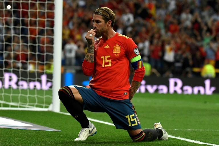 Bowing out: Sergio Ramos celebrated after converting a penalty against Sweden in Euro 2020 qualifying at the Santiago Bernabeu in Madrid