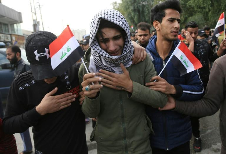 An Iraqi youth cries during the funeral procession of a prominent civil society activist who was shot dead the previous night (AFP Photo/Mohammed SAWAF)