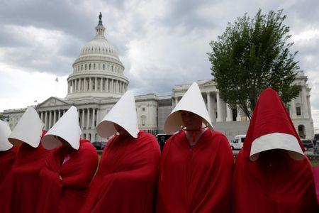 "Planned Parenthood volunteers dressed as characters from ""The Handmaid's Tale"" demonstrate against the Senate healthcare bill at the U.S. Capitol in Washington, U.S., June 27, 2017.   REUTERS/Joshua Roberts"
