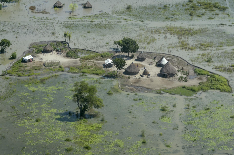 Thatched huts surrounded by floodwaters are seen from the air in Old Fangak county, Jonglei state, South Sudan Friday, Nov. 27, 2020. Some 1 million people in the country have been displaced or isolated for months by the worst flooding in memory, with the intense rainy season a sign of climate change. (AP Photo/Maura Ajak)