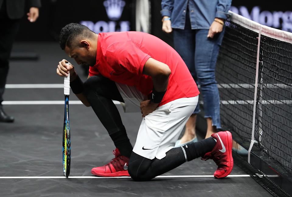 Nick Kyrgios of Team World joined NFL stars from Wembley by dropping his knee before his Laver Cup match with Roger Federer today during his mens singles match against Roger Federer of Team Europe on the final day of the Laver cup on September 24, 2017 in Prague, Czech Republic. (Photo by Julian Finney/Getty Images for Laver Cup)