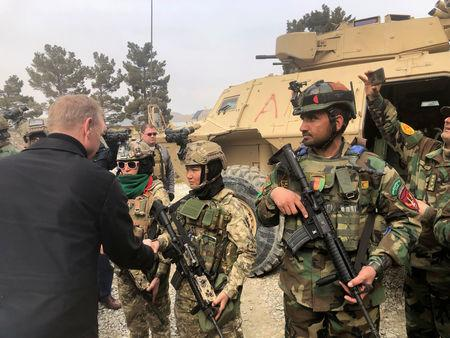 Acting U.S. defense secretary Patrick Shanahan meets with Afghan commandos at Camp Morehead in Kabul, Afghanistan February 11, 2019. REUTERS/Idrees Ali