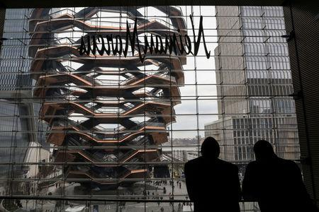 A large public art sculpture called 'The Vessel,' made up of 155 flights of stairs, is seen from inside the Shops during the grand opening of the The Hudson Yards development, a residential, commercial, and retail space on Manhattan's West side in New York City, New York, U.S., March 15, 2019. REUTERS/Brendan McDermid