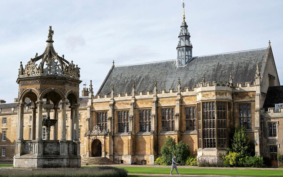 A fountain and the hall is pictured in Great Court at Trinity College, part of the University of Cambridge - JUSTIN TALLIS/AFP