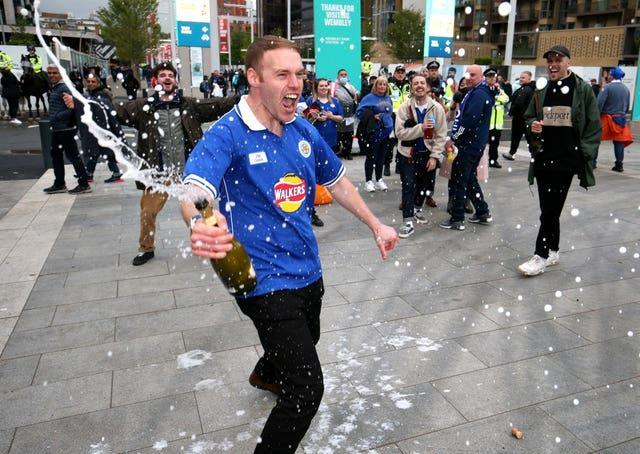 Leicester fans celebrate outside Wembley