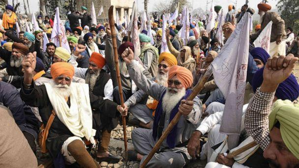 PHOTO:Farmers sit on railway tracks during a four-hour rail blockade as they continue their protest against the central government's recent agricultural reforms on the outskirts of Amritsar in India on Feb. 18, 2021. (Narinder Nanu/AFP via Getty Images)