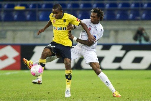 Cedric Bakambu (left) vies with Valenciennes' Brazilian defender Gil
