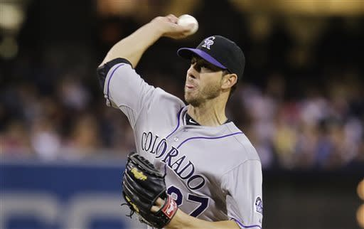 Colorado Rockies starter Jon Garland releases a pitch against the San Diego Padres during the first inning of a baseball game, Friday, April 12, 2013, in San Diego. (AP photo/Lenny Ignelzi)