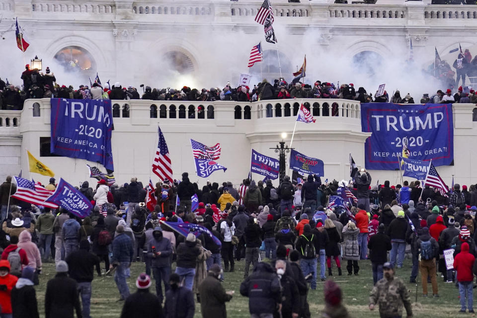"""FILE - Rioters supporting President Donald Trump storm the Capitol on Jan. 6, 2021, in Washington. Some of the best sources for """"Day of Rage,"""" a painstaking 40-minute video investigation into the Jan. 6 Capitol riot, were the rioters themselves — an irony given the hostility many had toward journalists. That's according to the executive in charge of the New York Times' project. (AP Photo/John Minchillo, File)"""