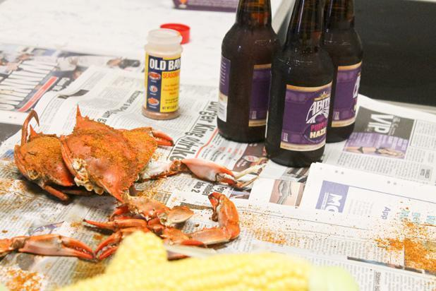 <p>Add another liberal dose of Old Bay to the top of the crabs, and make a couple piles out of it for easy dipping. </p>