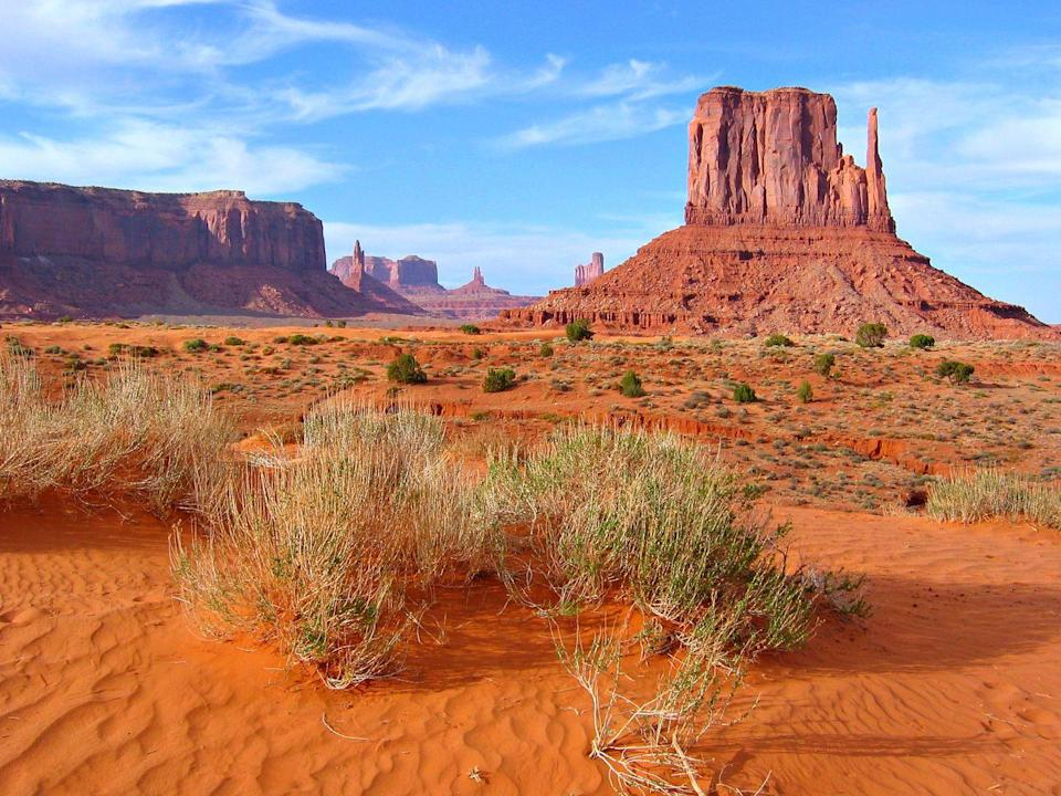 """<p>Located 315 miles outside of central Phoenix, every view in <a href=""""https://go.redirectingat.com?id=74968X1596630&url=https%3A%2F%2Fwww.tripadvisor.com%2FTourism-g57072-Monument_Valley_Utah-Vacations.html&sref=https%3A%2F%2Fwww.redbookmag.com%2Flife%2Fg36983852%2Funderrated-attractions-by-state%2F"""" rel=""""nofollow noopener"""" target=""""_blank"""" data-ylk=""""slk:Monument Valley"""" class=""""link rapid-noclick-resp"""">Monument Valley</a> is worthy of being photographed. A 13-mile scenic loop offers one of the best drives out there. </p>"""