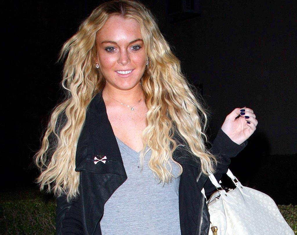"According to La Lohan's stylist, perms are back in style this spring. We, however, beg to differ. Big5/<a href=""http://www.x17online.com"" target=""new"">X17 Online</a> - April 15, 2008"