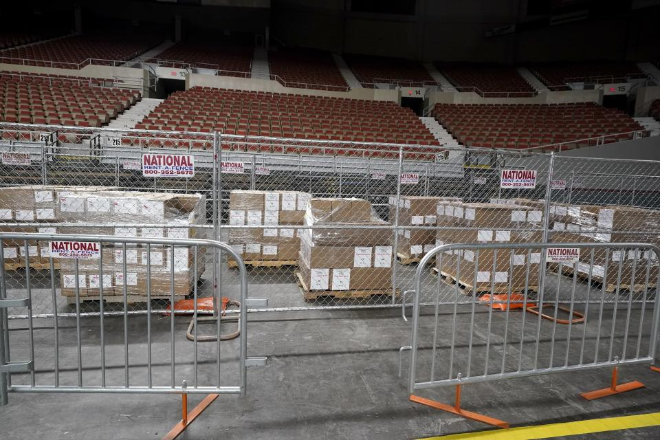 Some of the 2.1 million ballots cast during the 2020 election, ready for recounting at a 2020 election ballot audit ordered by the Republican lead Arizona Senate at the Arizona Veterans Memorial Coliseum, during a news conference Thursday, April 22, 2021, in Phoenix. The equipment used in the November election won by President Joe Biden and the 2.1 million ballots were moved to the site Thursday so Republicans in the state Senate who have expressed uncertainty that Biden's victory was legitimate can recount them and audit the results. (AP Photo/Ross D. Franklin)