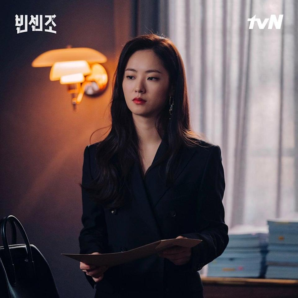 """<p>I truly could have watched an entire episode of just Cha-Young doing errands in this JayBaek Couture skirt suit and would have been riveted. The double-breasted silhouette! The pleated corset belt! It's no wonder JayBaek Couture is beloved by celebrities globally, but especially in Korea. Fun fact: for <a href=""""https://www.popsugar.com/celebrity/photo-gallery/45772477/image/45777765/BTS"""" class=""""link rapid-noclick-resp"""" rel=""""nofollow noopener"""" target=""""_blank"""" data-ylk=""""slk:BTS's very first Grammys in 2019"""">BTS's very first Grammys in 2019</a>, RM, Jin, Suga, Jimin, V, and Jungkook wore tuxedos designed by JayBaek (while J-Hope wore Kim Seo Ryong). </p><p>Shop Cha-Young's <a href=""""http://shop2.jaybaekcouture.cafe24.com/product/black-signature-skirts/426/category/80/display/1/"""" class=""""link rapid-noclick-resp"""" rel=""""nofollow noopener"""" target=""""_blank"""" data-ylk=""""slk:skirt"""">skirt</a> ($701) and <a href=""""http://shop2.jaybaekcouture.cafe24.com/product/black-silk-pleats-belt/427/category/80/display/1/"""" class=""""link rapid-noclick-resp"""" rel=""""nofollow noopener"""" target=""""_blank"""" data-ylk=""""slk:pleated belt"""">pleated belt</a> ($399). </p>"""