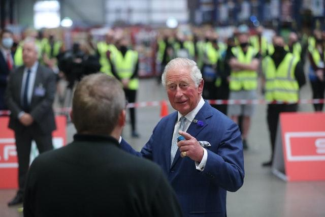The prince shares a joke with foodservice driver Stephen Taggart during a visit to the Henderson Group's food and grocery distribution centre. Niall Carson/PA Wire