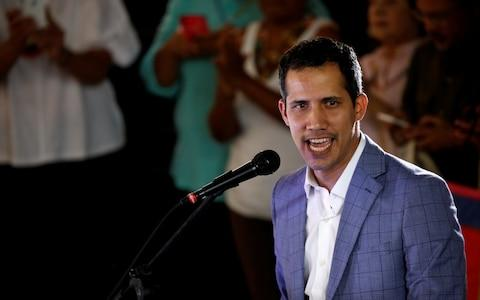 Venezuelan opposition leader Juan Guaido, who America has recognised as the country's rightful interim ruler - Credit: REUTERS/Marco Bello