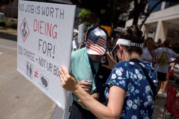 PHOTO: Anti-vaccine protesters hold signs outside of Houston Methodist Hospital in Houston, Texas, on June 26, 2021. (Mark Felix/AFP via Getty Images, FILE)