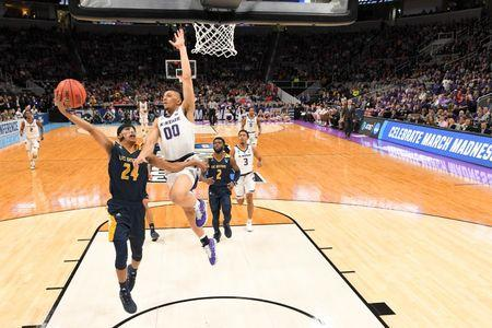Mar 22, 2019; San Jose, CA, USA; UC Irvine Anteaters guard Eyassu Worku (24) goes up for a shot as Kansas State Wildcats guard Mike McGuirl (00) defends during the second half in the first round of the 2019 NCAA Tournament at SAP Center. Mandatory Credit: Kyle Terada-USA TODAY Sports