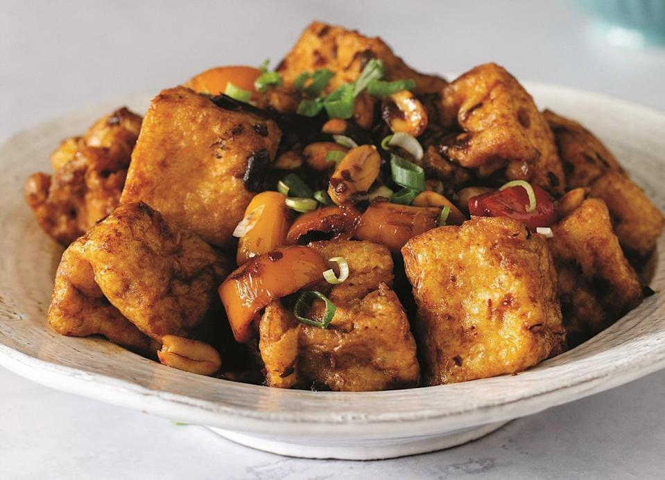 """<p>These kung pao tofu puffs are—dare we say—better than the chicken version. <a href=""""https://www.thedailymeal.com/cook/take-out-food-chinese-mexican-recipes?referrer=yahoo&category=beauty_food&include_utm=1&utm_medium=referral&utm_source=yahoo&utm_campaign=feed"""" rel=""""nofollow noopener"""" target=""""_blank"""" data-ylk=""""slk:Recreate this favorite takeout meal at home"""" class=""""link rapid-noclick-resp"""">Recreate this favorite takeout meal at home</a> and eat this flavorful tofu over rice or add it to a chow mein.</p> <p><a href=""""https://www.thedailymeal.com/best-recipes/kung-pao-tofu-puffs?referrer=yahoo&category=beauty_food&include_utm=1&utm_medium=referral&utm_source=yahoo&utm_campaign=feed"""" rel=""""nofollow noopener"""" target=""""_blank"""" data-ylk=""""slk:For the Kung Pao Tofu Puffs recipe, click here."""" class=""""link rapid-noclick-resp"""">For the Kung Pao Tofu Puffs recipe, click here.</a></p>"""