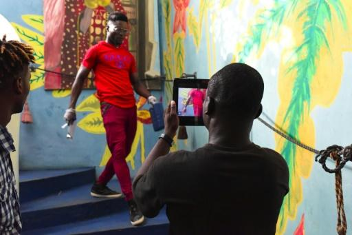 Smartphone filming at a workshop during the Bushman Film Festival at the end of March in Ivory Coast's economic capital Abidjan