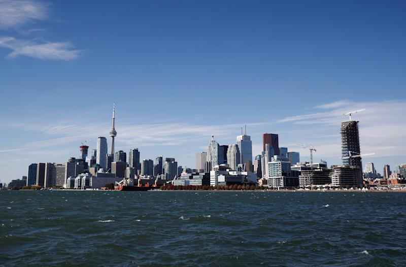 """Toronto skyline stands on the waterfront before Alphabet Inc, the owner of Google, announced the project """"Sidewalk Toronto"""", that will develop an area of Toronto's waterfront using new technologies to develop high-tech urban areas in Toronto, Ontario, Canada October 17, 2017.    REUTERS/Mark Blinch"""