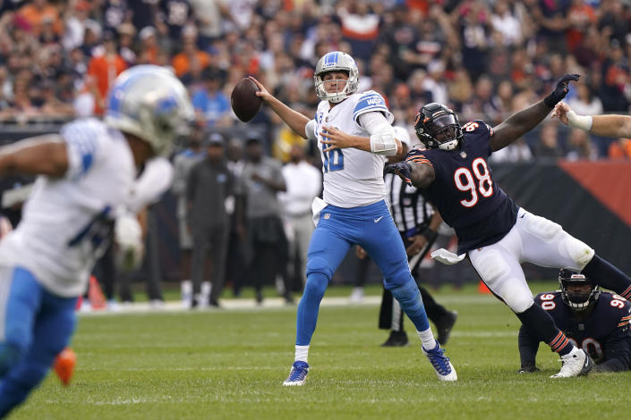 Detroit Lions quarterback Jared Goff passes under pressure by Chicago Bears defensive tackle Bilal Nichols during the first half of an NFL football game Sunday, Oct. 3, 2021, in Chicago. (AP Photo/Nam Y. Huh)