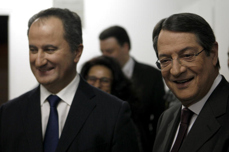 Right-wing opposition leader Nicos Anastasiades, right, maintaining a wide lead over his two main rivals for Cyprus' presidency, left-wing candidate Stavros Malas, left, smiles before the start of their live televised debate in capital Nicosia, Cyprus, Friday, Feb. 22, 2013. The conservative candidate Nicos Anastasiades in Cyprus' election runoff Sunday, Feb. 24, looks poised to become the crisis-hit country's new president charged with swiftly negotiating a rescue package with international creditors, analysts said Wednesday, even without a key endorsement from his third-place rival. (AP Photo/Petros Karadjias)