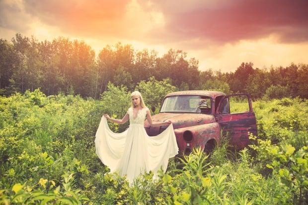 Cristiana Bodnariuc models a gown in front of one of the Boneyard's 1950s pickup trucks.