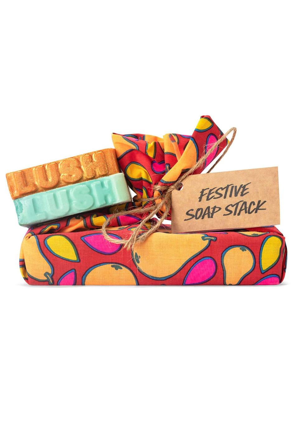 """<p><strong>Lush</strong></p><p>lushusa.com</p><p><strong>$20.95</strong></p><p><a href=""""https://www.lushusa.com/gifts/all-gift-sets/festive-soap-stack/9999960378.html"""" rel=""""nofollow noopener"""" target=""""_blank"""" data-ylk=""""slk:Shop Now"""" class=""""link rapid-noclick-resp"""">Shop Now</a></p><p>One thing your loved one most certainly needs and will use during a pandemic? Soap. These festive sets from Lush come tied together with a cotton wrap that can double as a hand towel. Plus, if you can't pick it up in person, Lush <a href=""""https://www.lushusa.com/stories/article_10-things-lush-packaging.html"""" rel=""""nofollow noopener"""" target=""""_blank"""" data-ylk=""""slk:ships items"""" class=""""link rapid-noclick-resp"""">ships items</a> in recyclable and compostable packaging.</p>"""