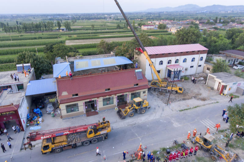 In this aerial photo released by Xinhua News Agency, rescue workers are seen near the site of a collapsed two-story restaurant in Xiangfen County of Linfen City, northern China's Shanxi Province on Saturday, Aug. 29, 2020. Rescue efforts ended at the restaurant in the northern China village that collapsed during an 80th birthday celebration for a resident, leaving more than two dozen dead, authorities said Sunday. (Yang Chenguang/Xinhua via AP)