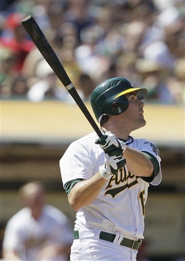 Oakland Athletics' Seth Smith hits a home run off New York Yankees relief pitcher Rafael Soriano during the ninth inning of their baseball game Sunday, July 22, 2012 in Oakland, Calif. (AP Photo/Eric Risberg)