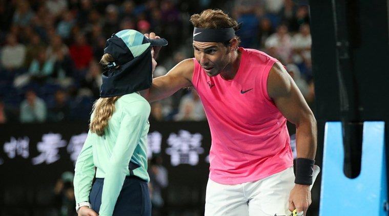 Nadal kisses ballgirl after his shot hits her; wins hearts