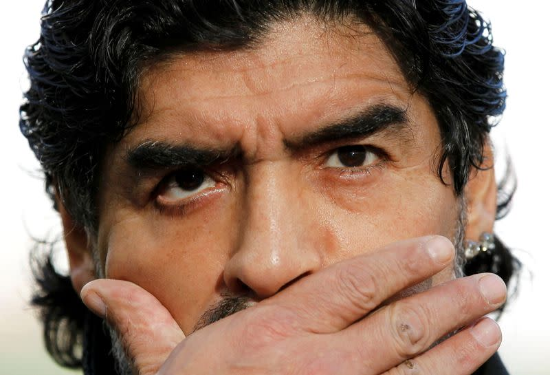 FILE PHOTO: Argentina's coach Maradona pauses while answering journalists' questions before the World Cup quarter-final soccer match against Germany in Cape Town