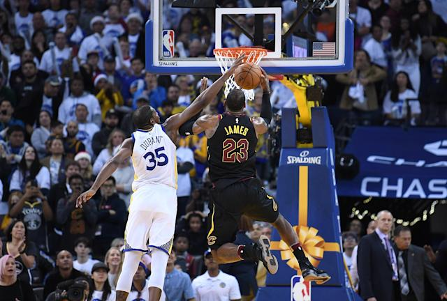 Kevin Durant, challenging LeBron James at the rim, has committed to turning himself into a defensive titan. (Getty)