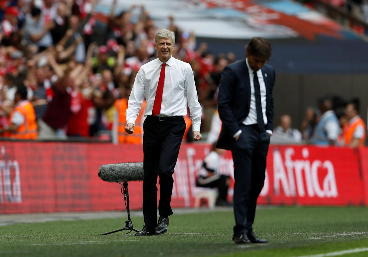 """Britain Soccer Football - Arsenal v Chelsea - FA Cup Final - Wembley Stadium - 27/5/17 Arsenal manager Arsene Wenger celebrates after Aaron Ramsey (not pictured) scores their second goal as Chelsea manager Antonio Conte looks dejected Action Images via Reuters / Lee Smith EDITORIAL USE ONLY. No use with unauthorized audio, video, data, fixture lists, club/league logos or """"live"""" services. Online in-match use limited to 45 images, no video emulation. No use in betting, games or single club/league/player publications.  Please contact your account representative for further details."""