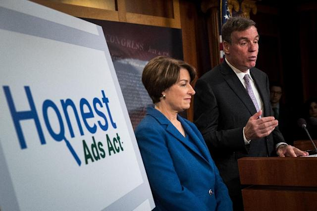 "Senators Amy Klobuchar and Mark Warner introduced the ""Honest Ads Act"" to require online firms to disclose sources of political ads, aimed at curbing foreign interference in US elections (AFP Photo/Drew Angerer)"