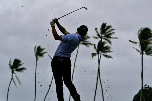 Collin Morikawa hits from the 11th tee during the third round of the Sony Open PGA Tour golf event, Saturday, Jan. 11, 2020, at Waialae Country Club in Honolulu. (AP Photo/Matt York)