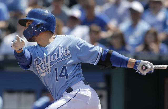 Kansas City Royals' Omar Infante watches a triple off Minnesota Twins starting pitcher Kevin Correia during the third inning of a baseball game at Kauffman Stadium in Kansas City, Mo., Saturday, April 19, 2014. (AP Photo/Orlin Wagner)