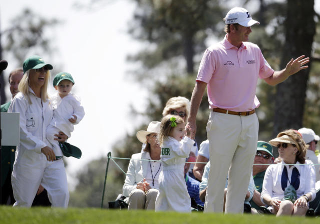 Brandt Snedeker arrives for the par three competition with his wife Mandy and children Austin and Lily, second right, at the Masters golf tournament Wednesday, April 9, 2014, in Augusta, Ga. (AP Photo/Darron Cummings)