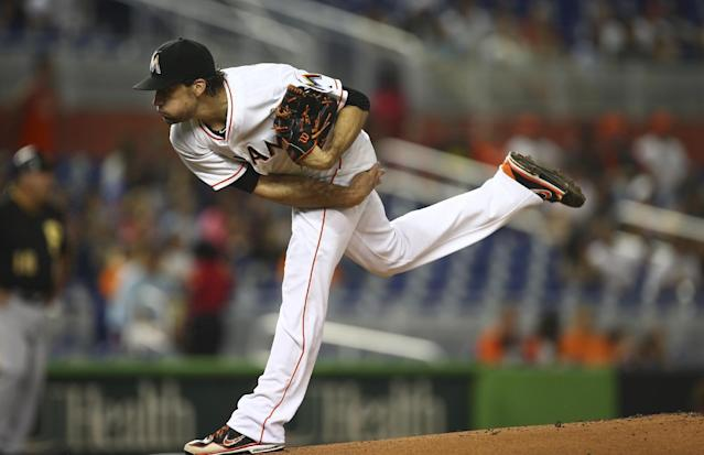 Miami Marlins starter Nathan Eovaldi pitches to the Pittsburgh Pirates during the first inning of a baseball game in Miami, Friday, June 13, 2014. (AP Photo/J Pat Carter)