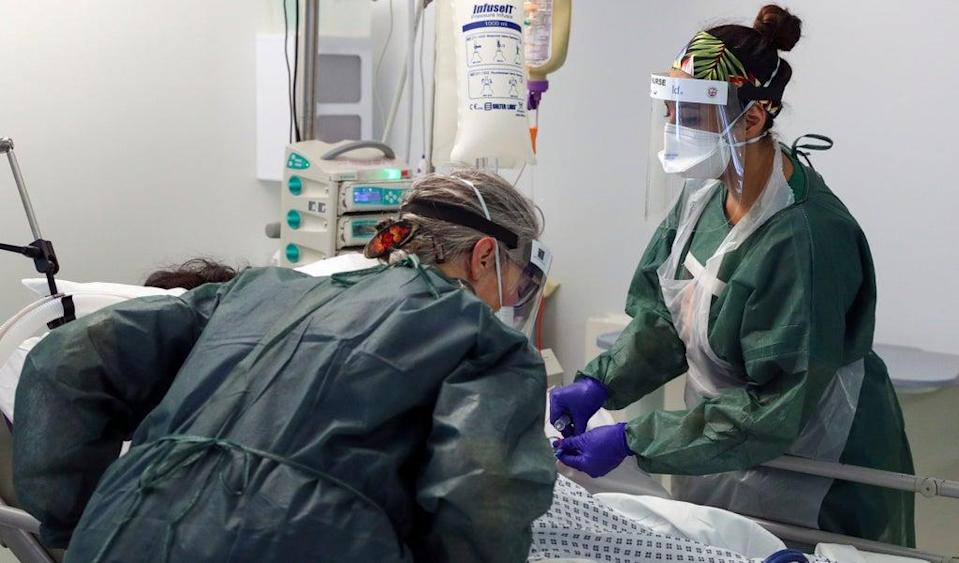Nurses care for a patient in an intensive care ward (Steve Parsons/PA) (PA Archive)