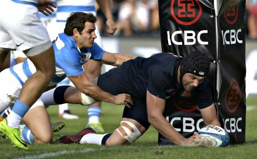 England's lock Charlie Ewels (R) scores a try while tackled by Argentina's Los Pumas fly-half Nicolas Sanchez during their Rugby Union test match at Brigadier General Estanislao Lopez stadium in Santa Fe, Argentina on June 17, 2017