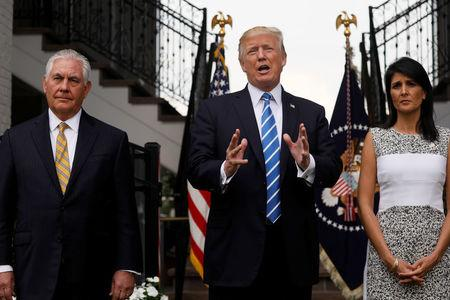 FILE PHOTO: U.S. President Donald Trump, flanked by Secretary of State Rex Tillerson (L) and U.S. Ambassador to the United Nations Nikki Haley (R) speaks to reporters after their meeting at Trump's golf estate in Bedminster, New Jersey U.S. August 11, 2017.  REUTERS/Jonathan Ernst