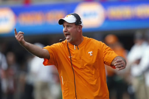 FILE - In this Sept. 29, 2018, file photo, Tennessee head coach Jeremy Pruitt yells to his players during an NCAA college football game against Georgia in Athens, Ga. Pruitt believes his team can benefit from the lessons he learned in his debut season as a head coach. (AP Photo/John Bazemore, File)