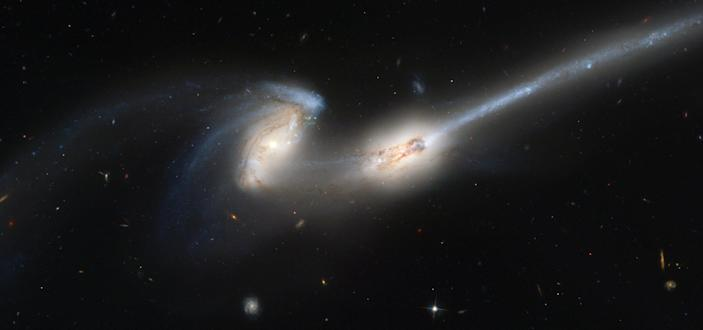 galaxies collide collision tidal tail galaxy mouse